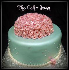 Elegant Pink Rose bud cake - This cake was ordered by a lady from NJ for her 90 year old grandmothers birthday in Louisiana.  She wanted something tiffany blue with pearls and pink roses.  We were really happy with how it turned out.  The cake was airbrushed with a pearl sheen to finish it off.  TFL!