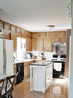 New stainless appliances, all white cupboards, affordable SANDABLE OAK COUNTERS