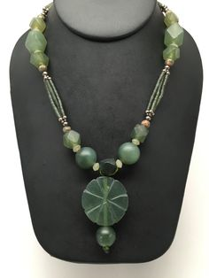 "77.5g Afghan Turkmen Tribal Green Jade Nephrite Round flower Bead Necklace, C152 Weight: About 77.5 Grams Length: About 21"" Beads Sizes: Vary, larger beads are about 9mm - 31mm Bottom Main Bead Dimension: About 31mm Stone Origin: Afghanistan Beads: About 1-2mm or so. Buyer will receive exact item as pictured! Please look at the images carefully before purchasing. I work hard and take pictures of each item and list them individually so my customers know exactly what they are getting. The…"