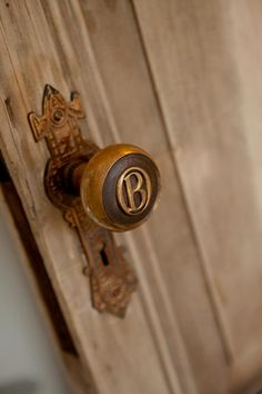 """An antique doorknob embossed with the letter """"B"""" adds a charming and customizing touch to the antique door at the entrance to Bebelle's room."""
