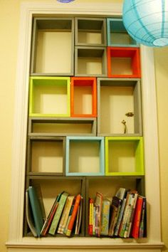 Colorful book case with colorful floor mat--light up my life!