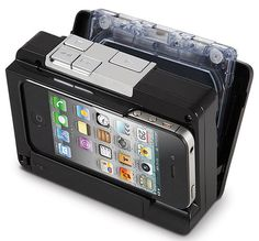 """""""This is the device that converts audio tape cassettes into MP3 files and stores them directly onto an iPhone or iPod touch. It accepts most iPhones and iPod touches, and normal or chrome cassette tapes."""" Size: 4 1/2"""" L x 3 1/4"""" W x 1 1/4"""" D."""
