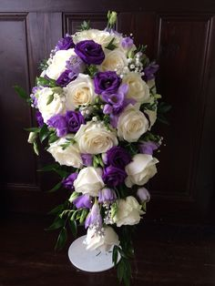 Image result for teardrop wedding bouquets white roses purple lisianthus and freesia