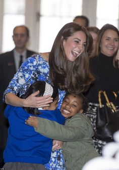 The Duchess of Cambridge proved to be a hit as she was showered with hugs from children du...