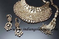 Gold and Diamond jewellery designs: amrapalli kundan bridal gold necklace set