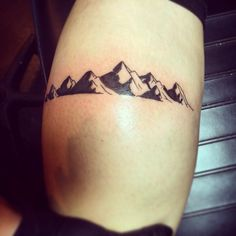 """She will move mountains"" ; calf tattoo"