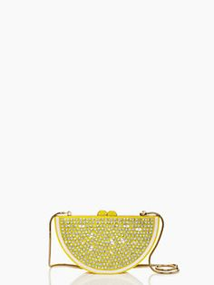 break this little day clutch out and just watch the oohs and aahs pour in. the lemon lina, with its sparkly seeds, not only an instant smile-inducer, it's a functional little carry-along with a secure snap closure, hidden snake chain, and just enough room for your essentials.