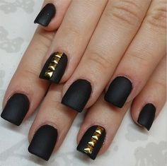 Black matte nails, with gold studs.