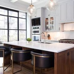 Brown Kitchen Island with Barrel Back Counter Stools