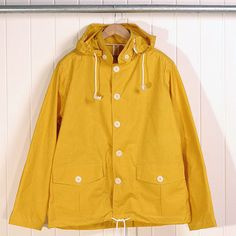 Yellow raincoat with buttons