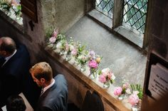 Small jar flower ideas in the church at Hengrave Hall, Suffolk wedding venue                                                                                                                                                      More