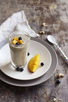 Cashew Nut Smoothie With Blueberries And Mango: 100g unsalted cashew nuts  300ml chilled water  1 ripe mango, stoned and flesh chopped  1 cup blueberries  1/4 cup ice cubes  1 tablespoon linseeds or chia seeds  1 tablespoon porridge oats  1 tablespoon honey