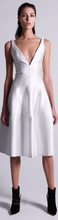 J. Mendel.Pre-Fall 2015. A stunning, plain white tulle dress with detailed seam torso and plunging neckline. Super easy to dress up and down and those are 100% the best types of dress a girl can own.