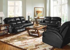 Easton Black Leather Collection | Furniture.com. Black leather dual reclining sofa with curved arms and accent stitching.