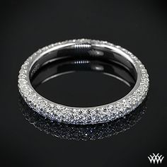 Custom Diamond Wedding Ring is set in platinum and is a full eternity design holding 0.75ctw A CUT ABOVE® Hearts and Arrows Diamond Melee.
