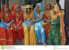 Daily Life:This picture is a picture of women that live in India. As you can see, they are all wearing very similar outfits. Men and women both wear very different things on a daily basis.  Women wear very similar things. Women wear what is called a serre or a long piece of fabric, with a colorful pant suit. Most women in India are covered in big pieces of jewellery,  Men wear a very basic outfit. They wear long pants, and a piece of fabric just wrapped around their waist.