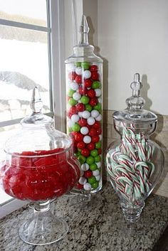 Christmas candy.. Decorating for fun and whimsy and inexpensively with colorful candy in clear urns.