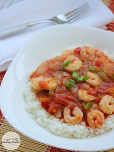 Shrimp Creole - Spicy shrimp, tomatoes, onions served on a bed of rice. This dish is always a hit!