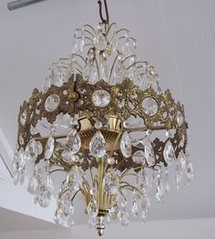This chandlier is actually in my mom's house.  It's circa 1972 and was bought through JC Penney catalog.