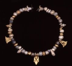 Phoenician gold and glass necklace found at Tharros. 4th century B.C. Tharros, Sardinia, Italy Trustees of the British Museum.