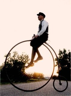 times in history | Man on penny farthing Victorian costume history