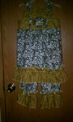 Black and Gold outfit made by Kristi's Creations.