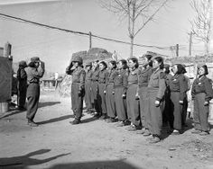 A platoon of the Korean Women's Army prepares for inspection at a command post somewhere in Korea. This group plays an active and important part in Korea's fight against Communism. Many such women are currently fighting on the front lines with their fathers and brothers.