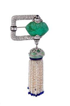 An Art Deco carved emerald, diamond, jadeite, pearl and lapis lazuli brooch, circa 1925.