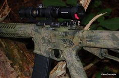 CamoConcepts painted this LWRC SIX-8 this week. Anything but plain! #camo #camopaint #camoconcepts #rifle #lwcr #six8 #leupold #camoconcepts.net