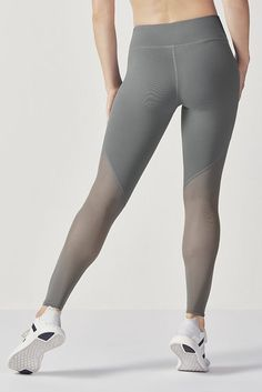 f7cee304726d9f Confident sessions start with a slimming mesh-paneled legging, featuring a  convenient zipper pocket