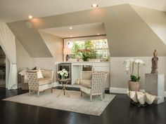 This dormer area provides a perfect place to sit and relax, complete with comfortable chairs and a wine refrigerator.