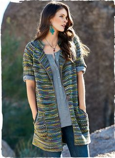 Our colorful, tweeded cardigan is knit in shifting hues of green, gold, blue and violet pima. The textural, versatile piece is styled with a ribbed stand collar, short raglan sleeves, pockets and crocheted trim.