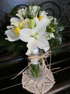 Wedding bouquet- white roses, white lilies, yellow freesia, white calla lilies, and treefern