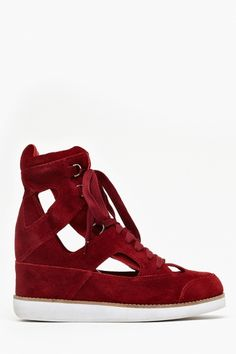 Not sure if my taste has suddenly plummeted, but this is the only hidden wedge sneaker I've been intrigued by. // Jeffrey Campbell via Nasty Gal