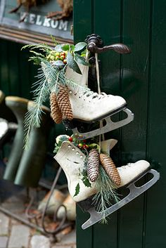 Old Ice Skates with Pine Cones, Berries, & Greenery on Door Knob