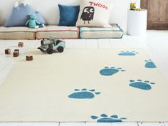 It was a happy accident when our brilliant rug weavers left a tin of teal blue paint by their pit loom. Rumour has it that a cheeky bear crept by.