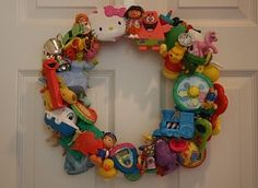 Toy Wreath! Before you throw out those small toys read this.. All you need is a wooden wreath from a craft or dollar store, a hot glue gun, and whole lotta toys.