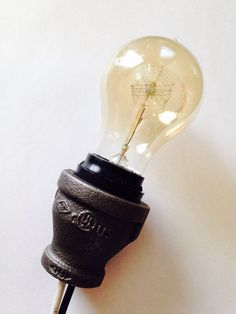 This is a pipe-lamp bulb socket. They can fit or inch pipe. Please leave a note on the size you would like. Note that bulb is not included. Pipe Lighting, Rustic Lighting, Cool Lighting, Lamp Socket, Lamp Bulb, Insulator Lights, Lamp Switch, Diy Pipe, Light Works