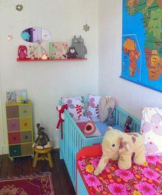 I love the idea of a world traveler nursery! So bright.