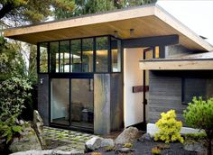 """Olson Kundig Architects, Riley's Cove Residence, Seattle WA 2009: """"This remodel and addition to a 1950s house opens up the original floor plan and creates a new entry sequence, providing a view through the house and reinforcing indoor-outdoor connections..."""""""