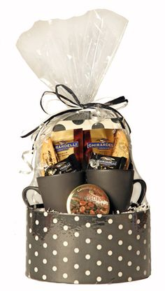 Her Coffee Gift Basket This super cute, reusable hatbox is filled with two coffee mugs, hot chocolate, chocolates, candies, biscotti, and a dotty picture frame. A great gift for one of the girls at work, a teacher, or any girl that likes chocolate (and who doesn't!)
