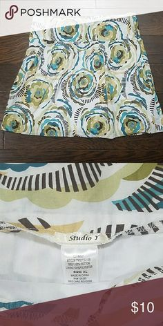 Womens a-line floral skirt, sz XL Retro floral print, womens lined a-line skirt with a hidden side zipper and earthtone colors of brown, teal, yellow and green. This skirt would be perfect for back to school this fall, paired with a sweater and leggings. Previously loved, excellent condition. 100% smoke and pet free home. Studio Y Skirts A-Line or Full