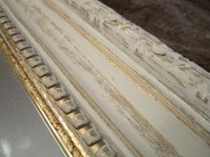 Gold mirror painted Paris Grey then sanded to see some of the gold then clear wax.