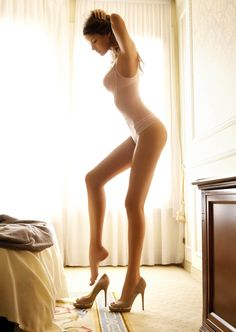 Love a Lingerie Beauty in Heels... and she can wield a paring knife too.