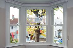 Inside view looking out of closed white uPVC Sliding Sash windows from Everest