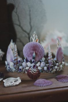 ☾ ☆☽  Inspired by my beautiful and inspiring friend Leana of the Coconut, Lemon & Lime Blog. Lavender hues with pale purple, gray and white shells come together to compose this dreamy mermaid crown. Designed for the wild at heart who longs for the sea and will never stop believing in magic. Handmade in California with real seashells attached to an adjustable base with lace ribbon closure. About 18 inches in diameter at smallest setting. Due to the handmade nature of this item, each shell…