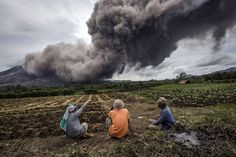 Mount Sinabung Spews Volcanic Ash As Villagers Are Refusing To Leave Their Homes (PICTURES)