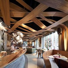 El Equipo Creativo was the firm tasked with making the union happen. Laminated strips of tropical mongoy wood was used for the ceiling installation, which were moulded into eight different shapes in metal casts designed digitally in 3D...