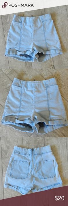 High-Waisted Stretch Shorts Material is a blend of denim and spandex/cotton, so they are stretchy.  Real pockets on the back. Urban Outfitters Shorts