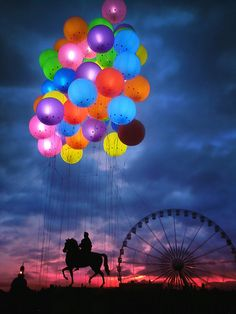 Balloons above The Silhouette of Louis XIV Statue ~ Lyon, France